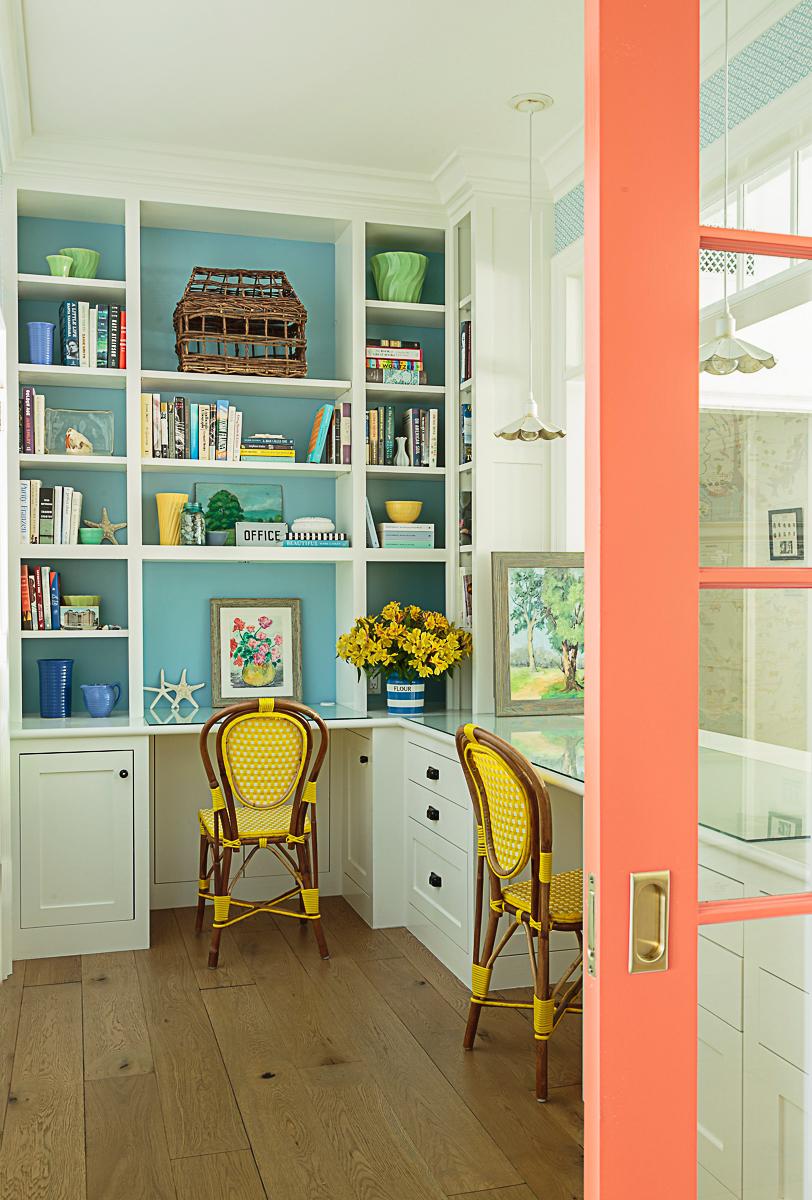 Love this home office with orange pocket door kellyelko.com