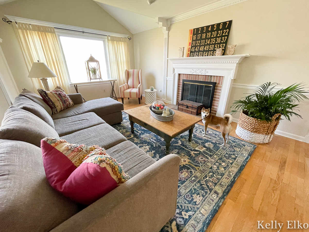 Home Staging After - love the colorful rug and vintage art on mantel kellyelko.com