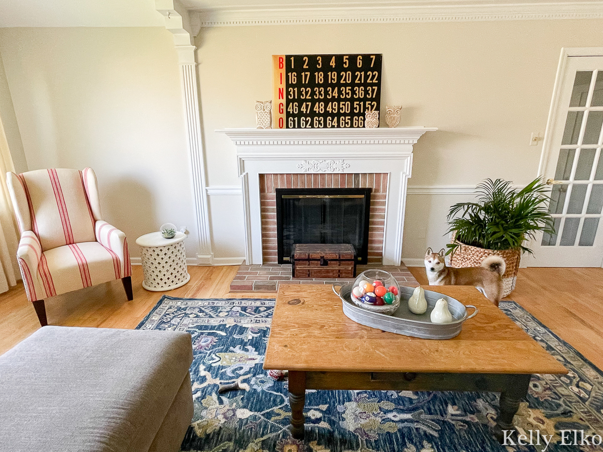 Home Staging After - love the colorful rug and vintage Bingo board on mantel kellyelko.com