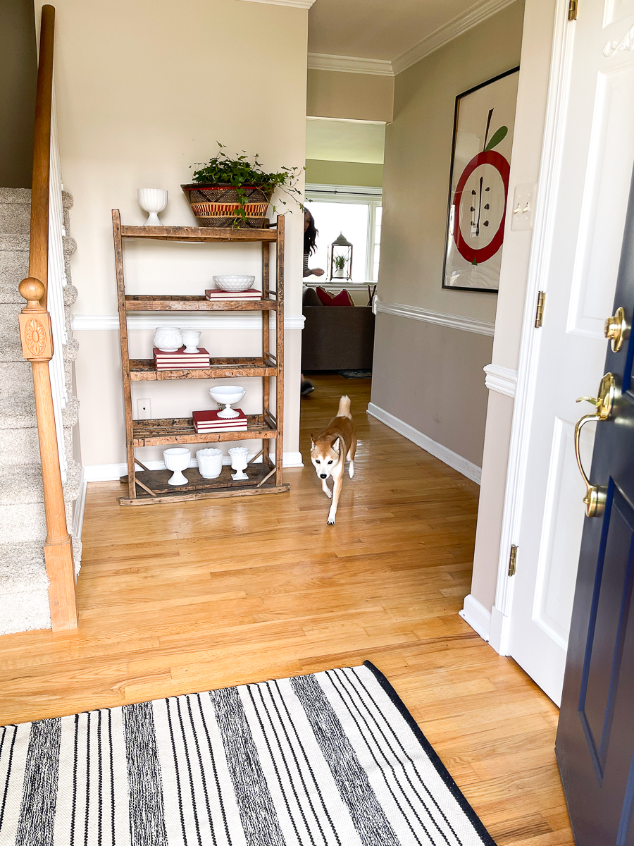 Home Staging After - love this beautiful entry with antique wood rack kellyelko.com