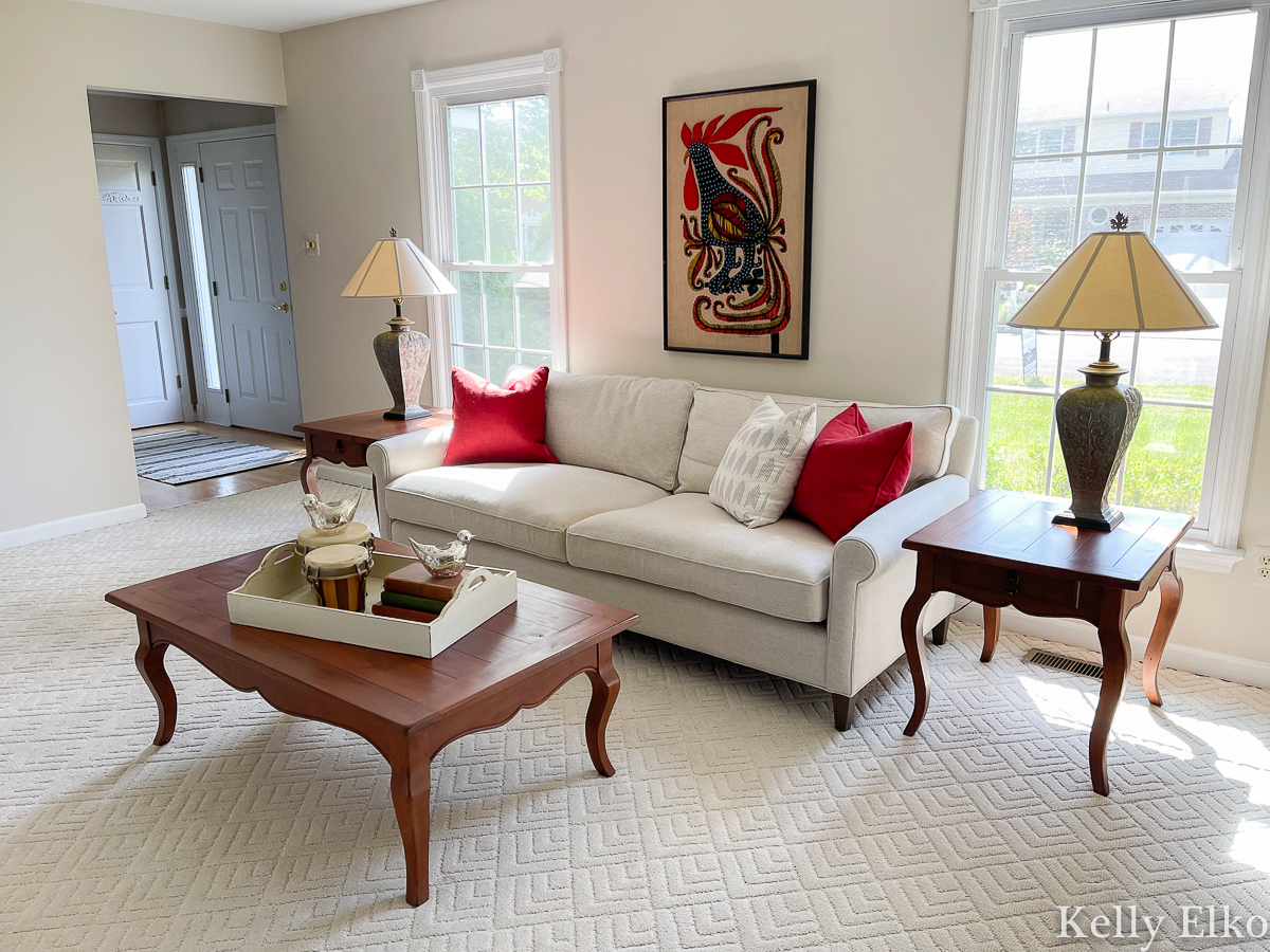 Home Staging - Love this living room with colorful vintage embroidered rooster art kellyelko.com