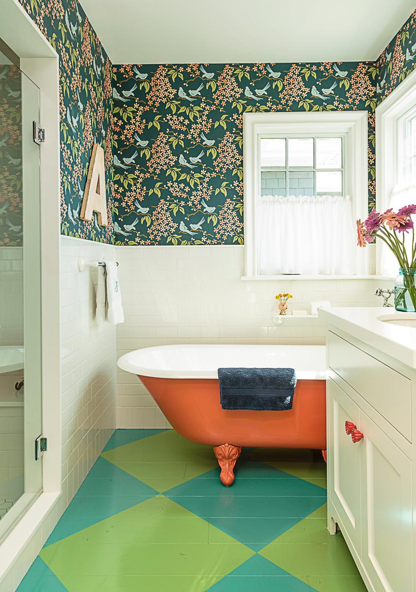 Colorful bathroom with blue and green diamond painted wood floors and orange clawfoot tub kellyelko.com