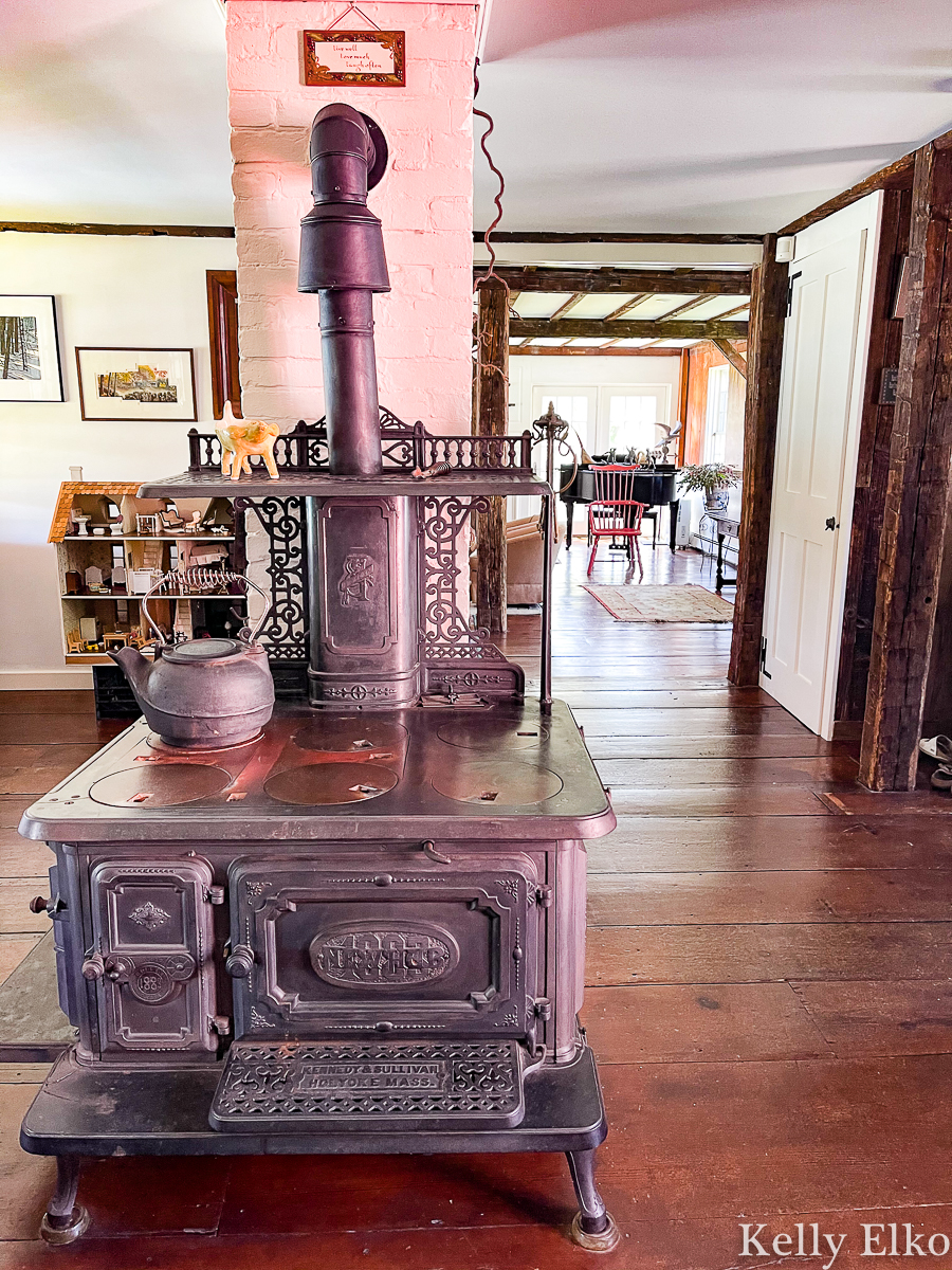 Love the original wood burning stove in the historic William Marston house on Cape Cod that is available to rent kellyelko.com