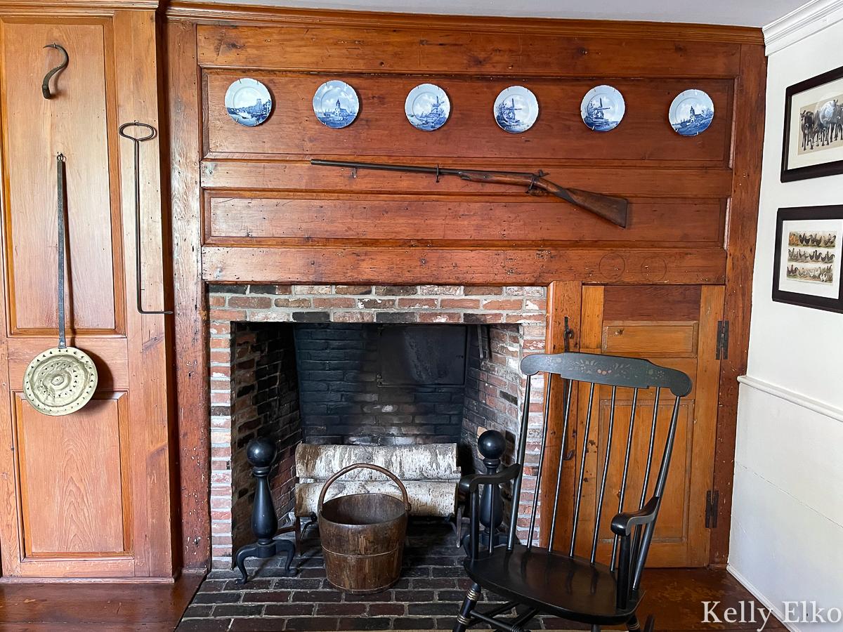 Original wood burning fireplace in this historic kitchen kellyelko.com