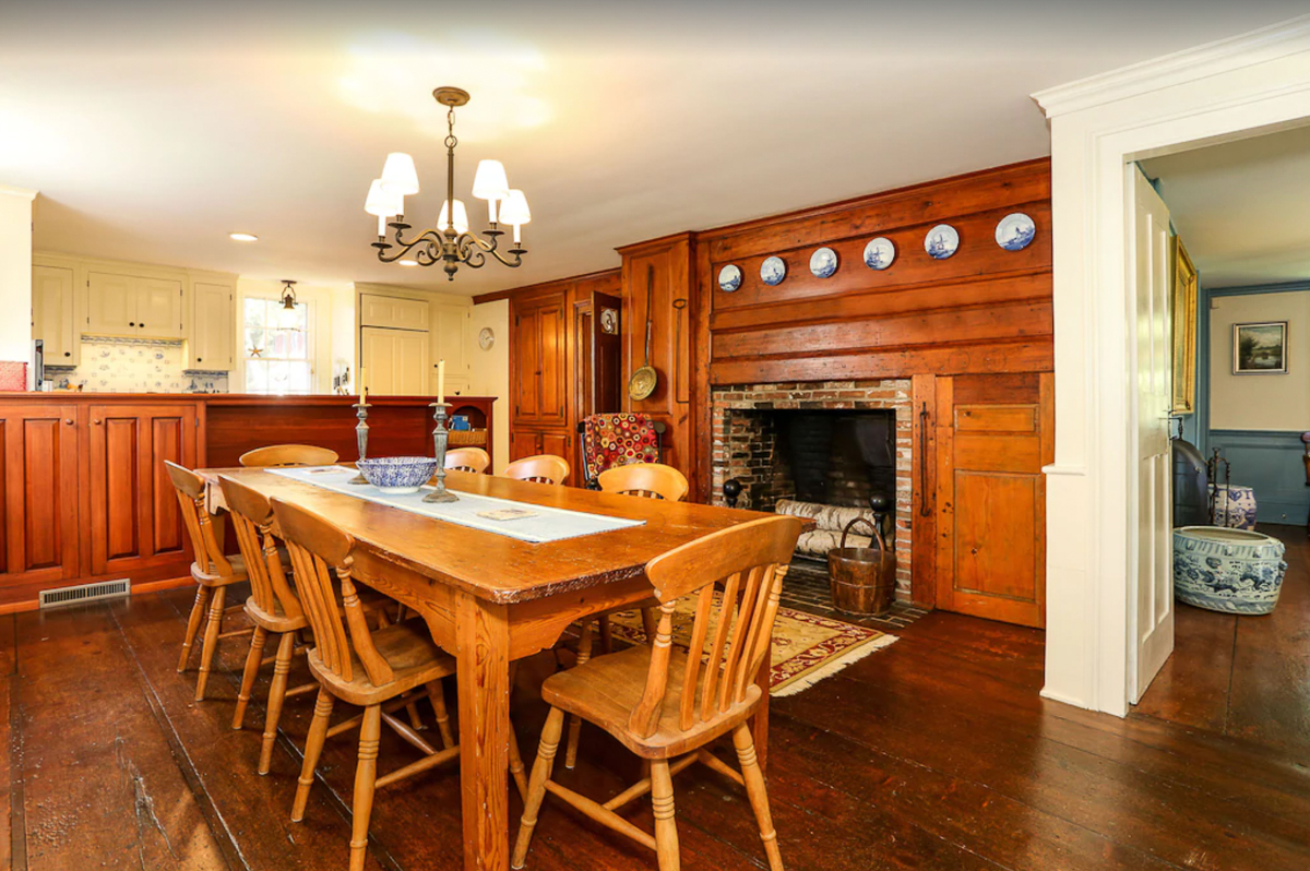Love this original wood and huge fireplace in this historic home kitchen kellyelko.com