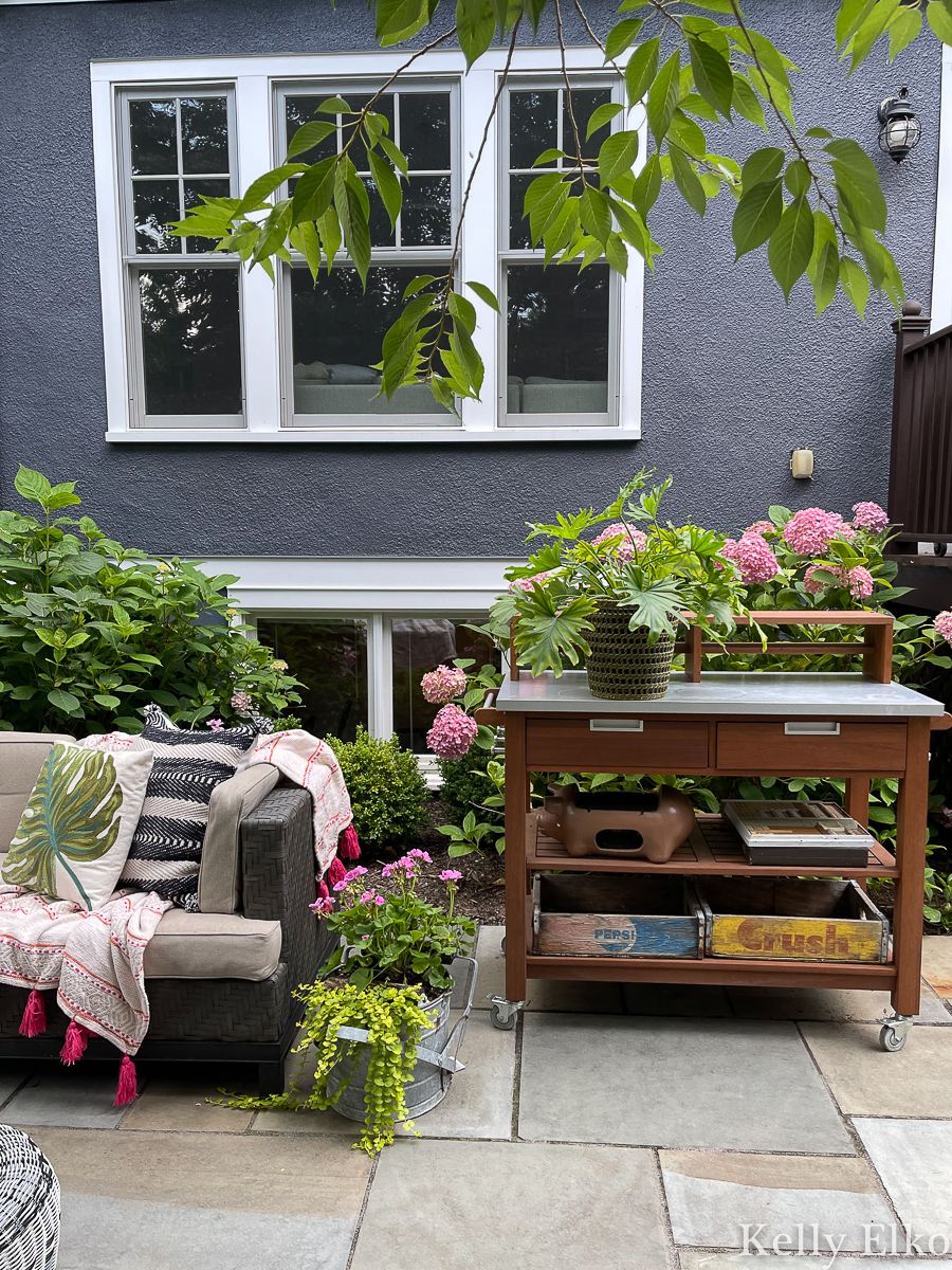 Love this potting bench turned bar cart on this stunning bluestone patio kellyelko.com