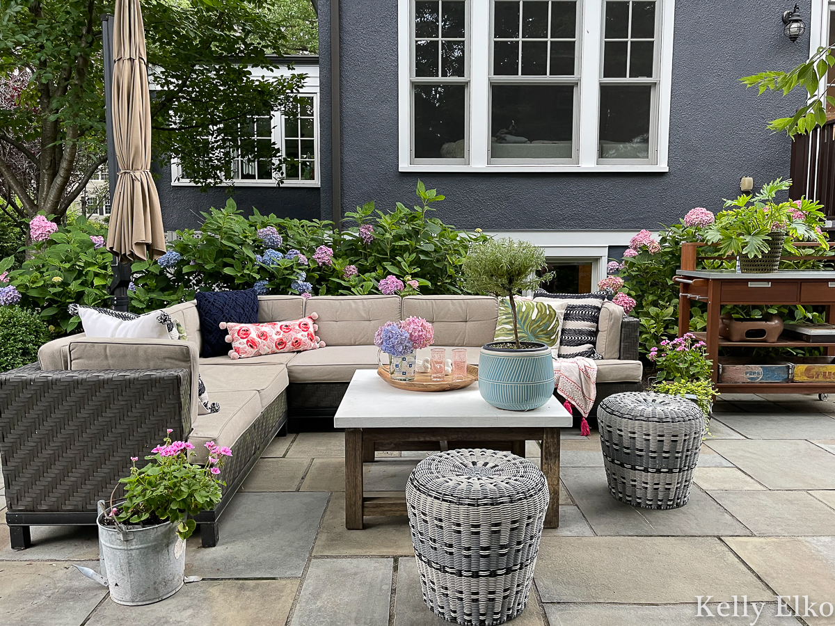 Beautiful bluestone patio with large outdoor sectional sofa and tons of gorgeous hydrangeas kellyelko.com