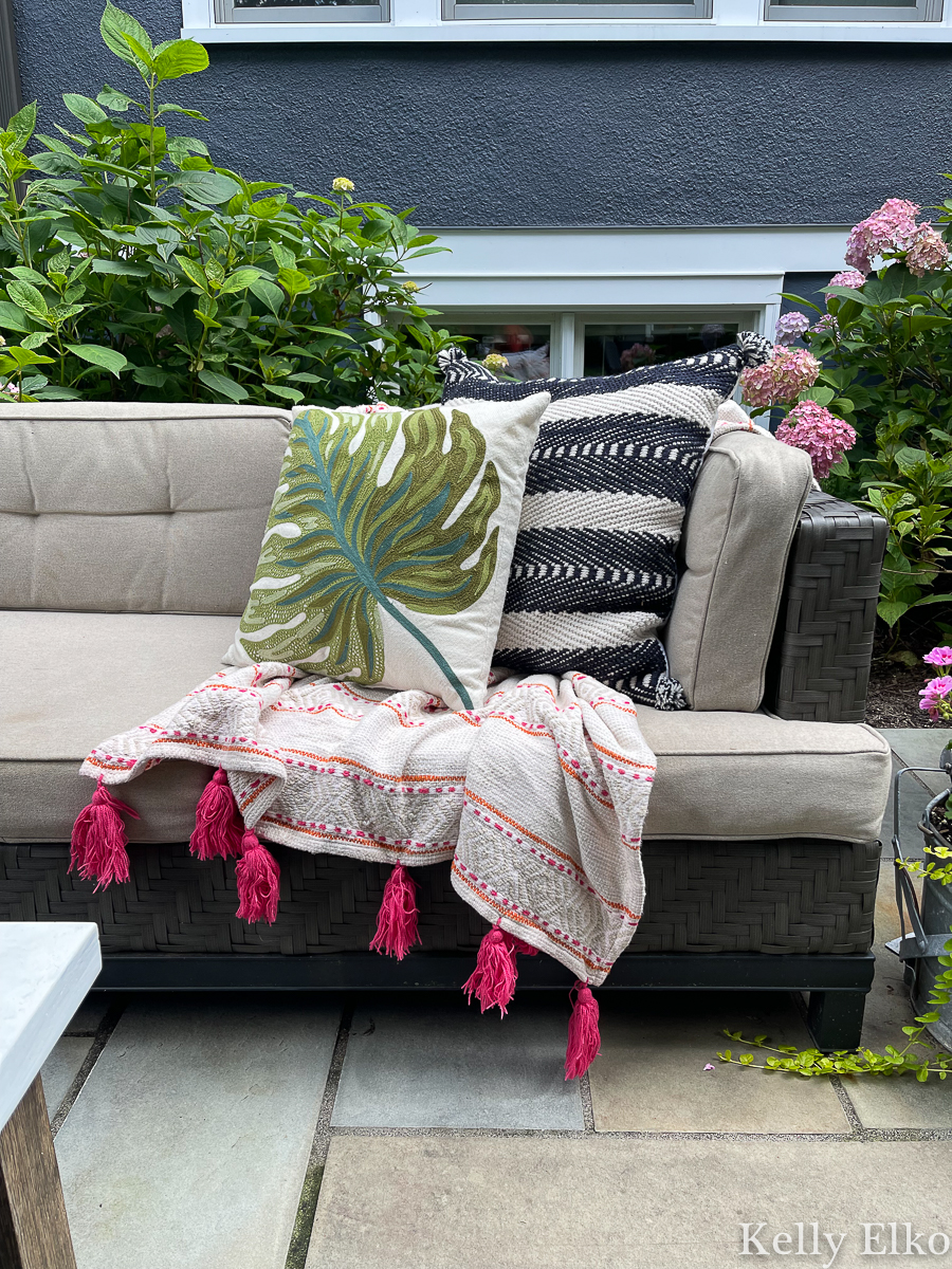 Colorful throw and outdoor pillows for an outdoor sofa kellyelko.com