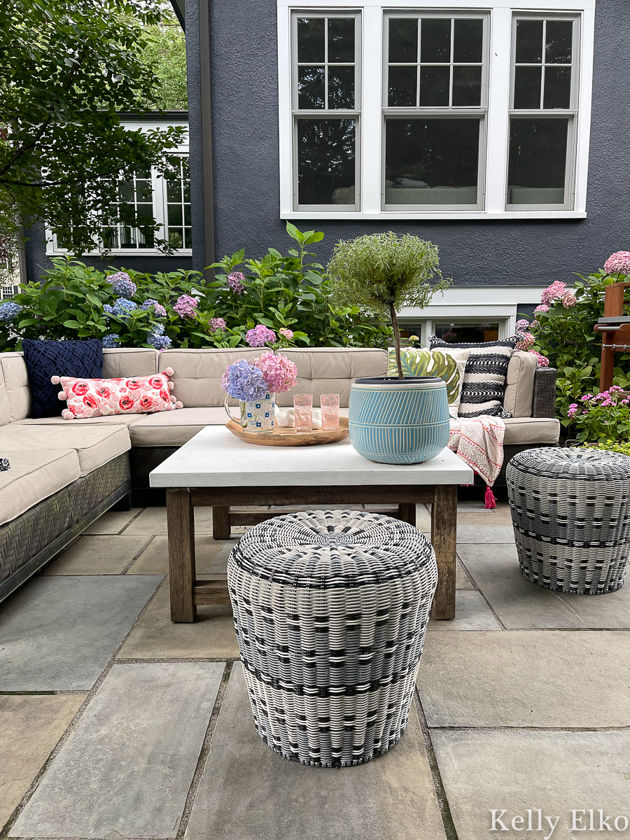 Love the outdoor sectional sofa and large coffee table in this stunning hydrangea filled backyard kellyelko.com