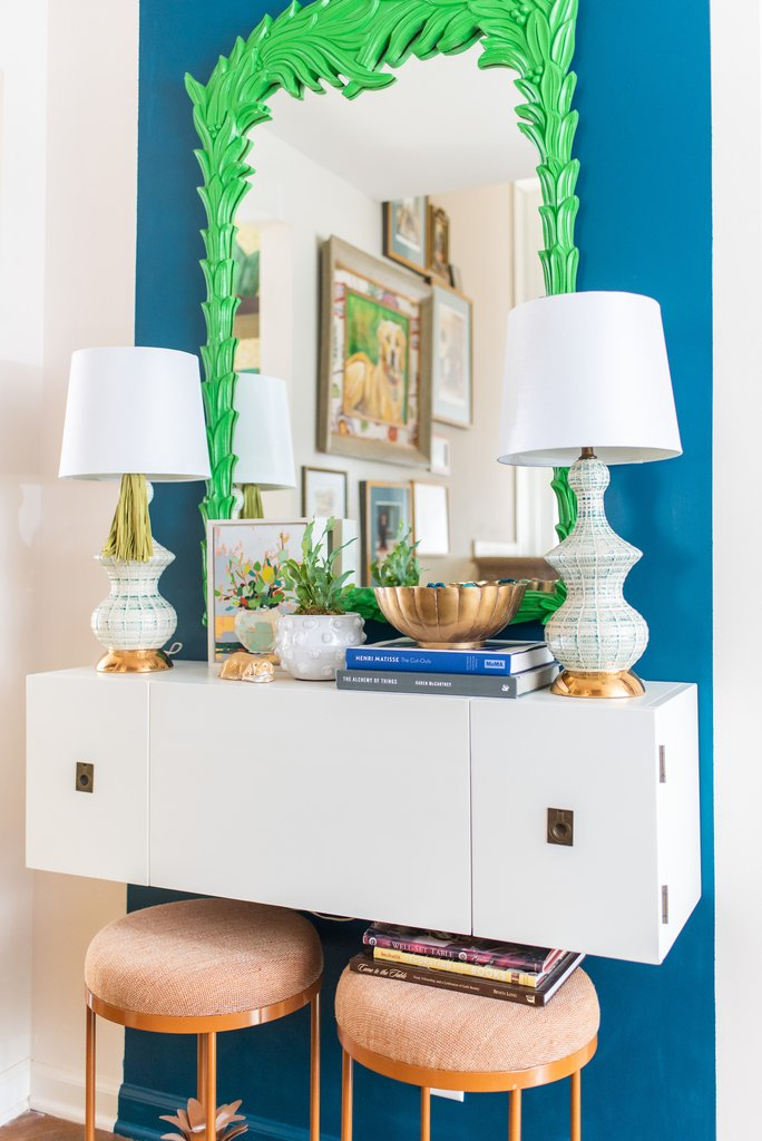 Add a pop of color to a white wall by painting a stripe of blue or other boldly colored paint kellyelko.com