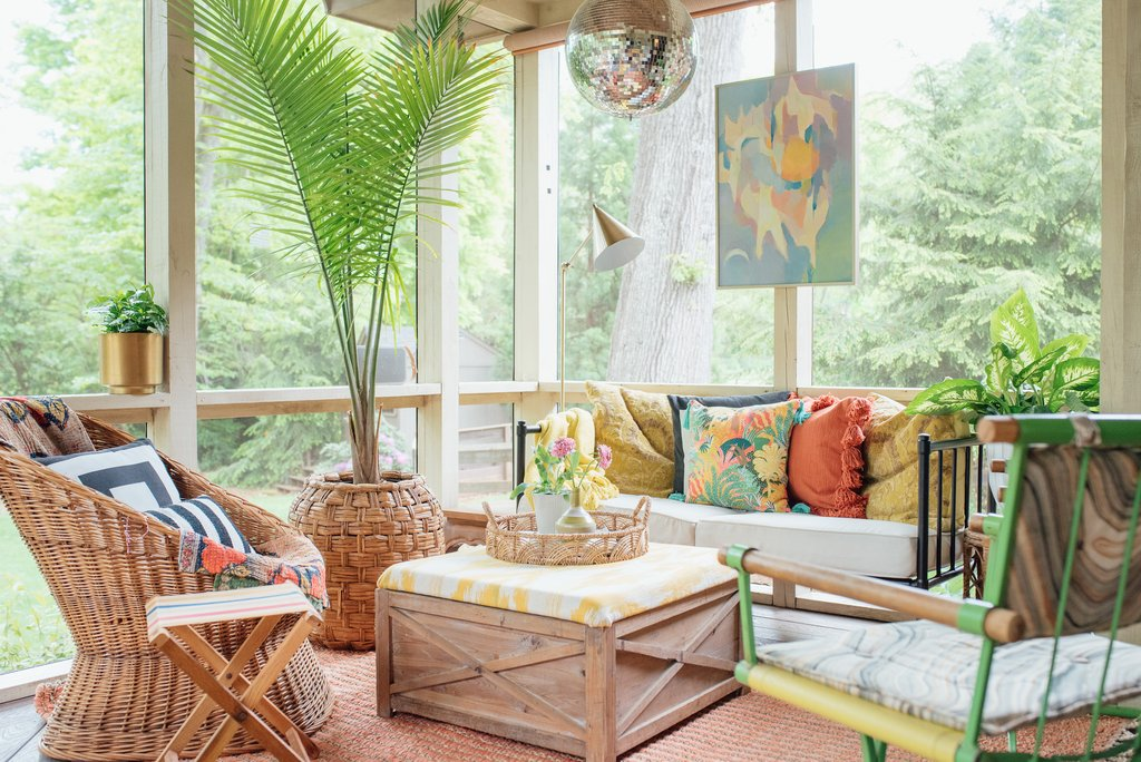 Beautiful boho screened in porch with wicker furniture and a disco ball kellyelko.com