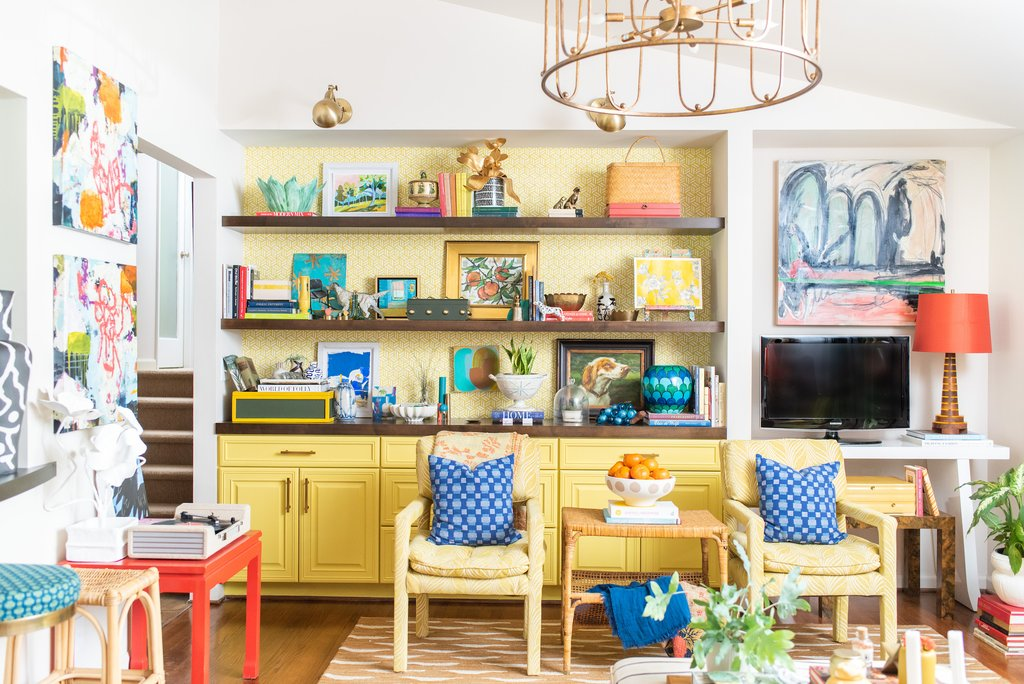 Eclectic and colorful family room with yellow built-ins and fun vintage collections kellyelkoi.com