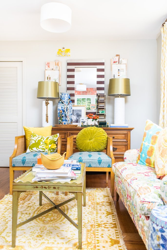 Colorful and eclectic family room with vintage furniture and colorful upholstery kellyelko.com