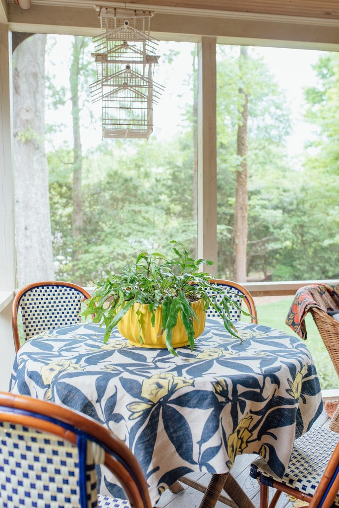 Love this porch furniture with blue bistro chairs and floral tablecloth kellyelko.com