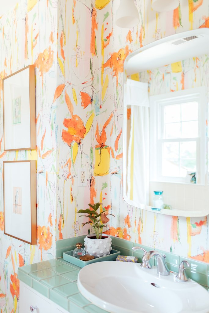 Add wallpaper to an outdated bathroom to focus the eye away from imperfections kellyelko.com