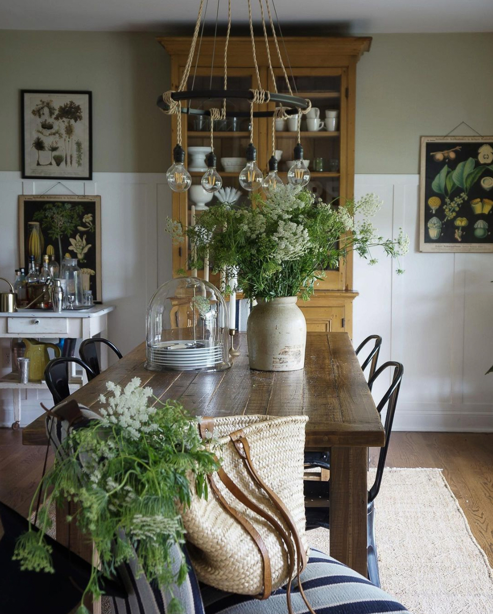 Love this farmhouse dining room filled with flowers and botanical prints kellyelko.com