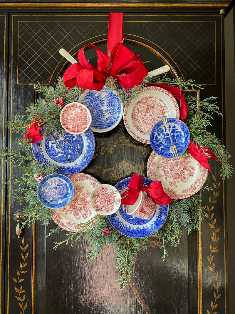 How to make a plate wreath - without damaging your precious plates! Love this blue and red plate wreath kellyelko.com