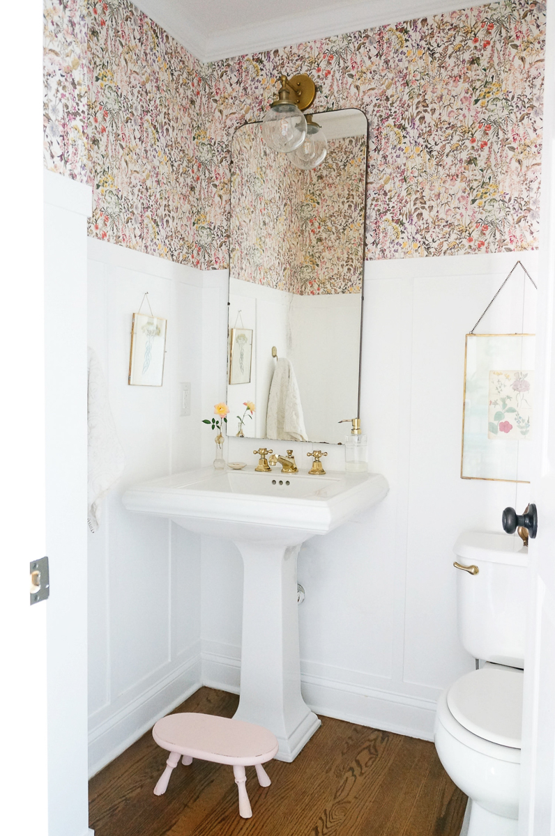 Powder room with floral wallpaper, wainscoting and brass lighting and fixtures kellyelko.com