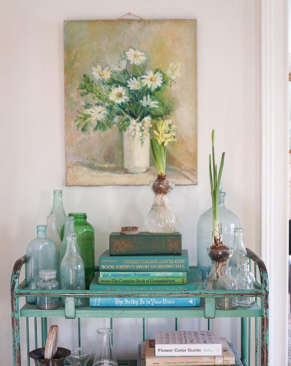 Vintage painting, book, industrial cart and glass jars kellyelko.com