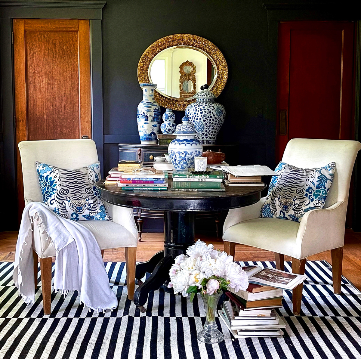 Love this library with antique round table and dark and moody paint kellyelko.com