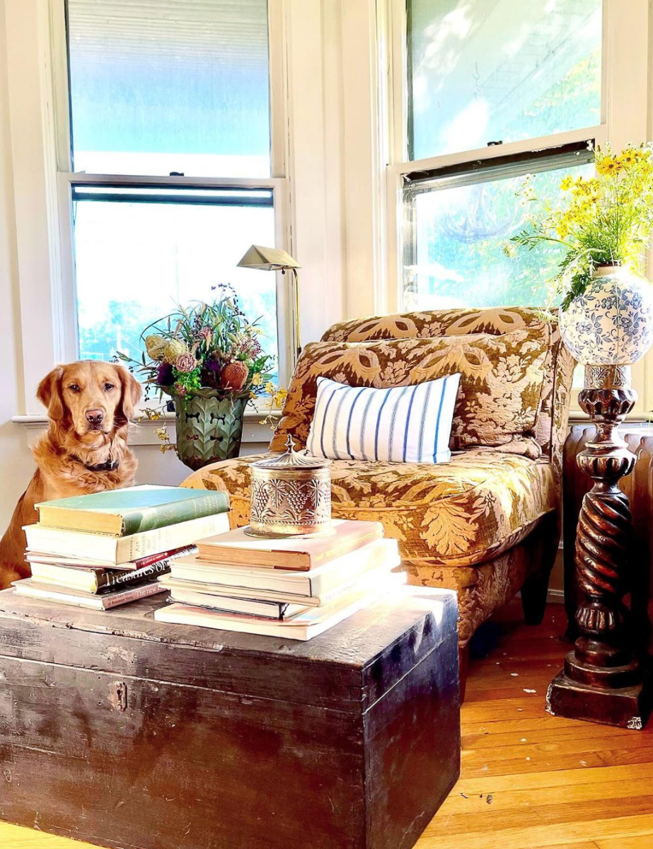 Cozy reading corner - love the old trunk piled high with books kellyelko.com