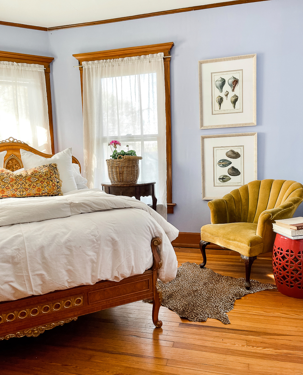 Grandmillennial bedroom filled with an eclectic mix of antiques including the stunning antique bed kellyelko.com