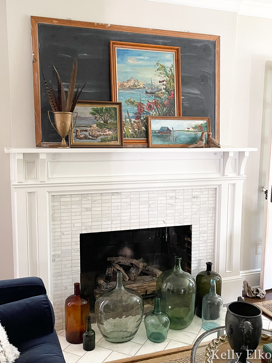 Stunning fall mantel with a trio of vintage seascapes and bottle collection kellyelko.com