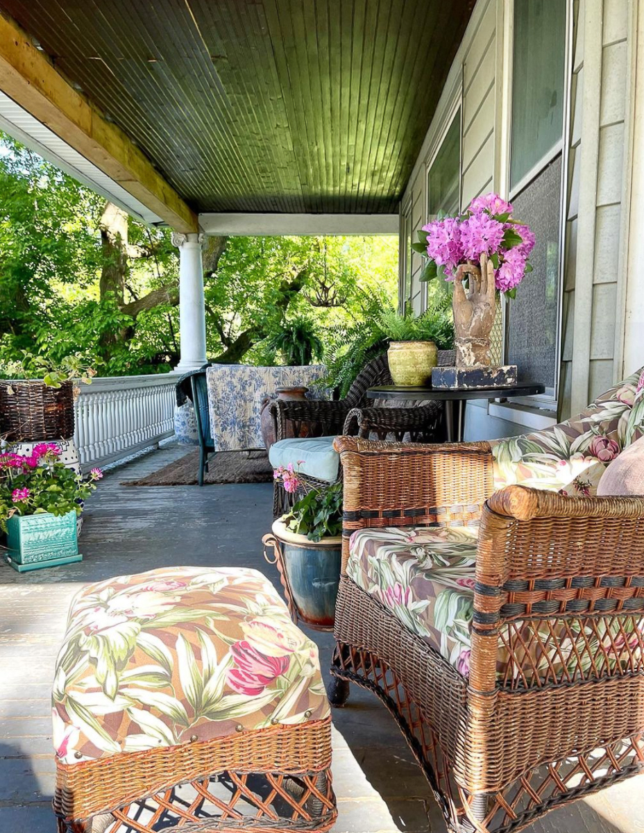 Old farmhouse porch - love all the wicker furniture and the dark painted roof and floor kellyelko.com