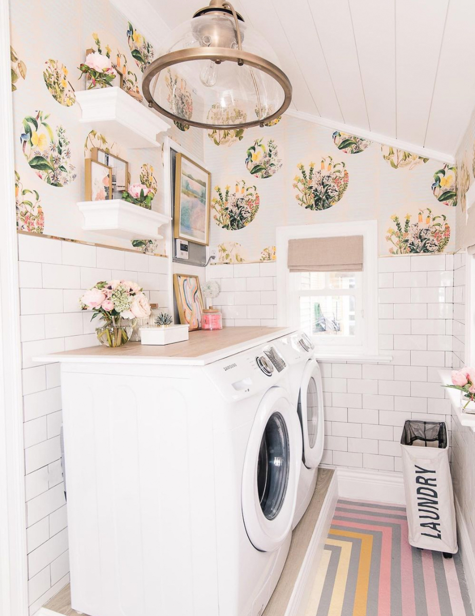 Love the wallpaper in this laundry room with subway tile and a rainbow stripe floor kellyelko.com
