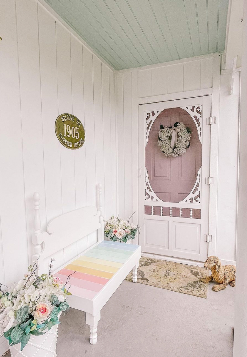Love this DIY bed turned bench painted in rainbow stripes kellyelko.com