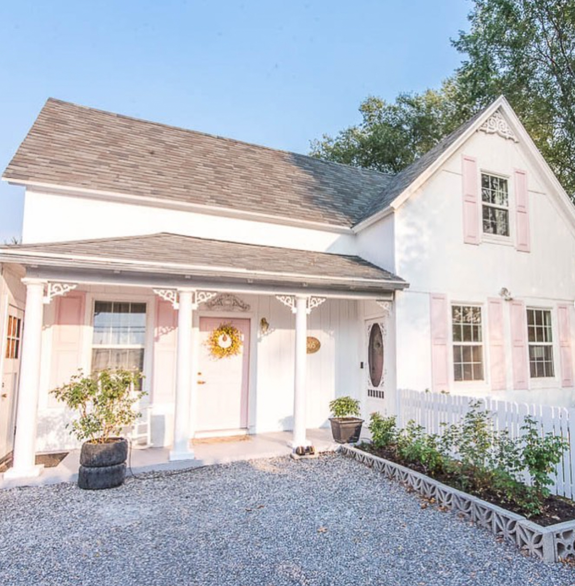 Tour this charming 1905 cottage straight out of a fairytale with pink shutters and door kellyelko.com