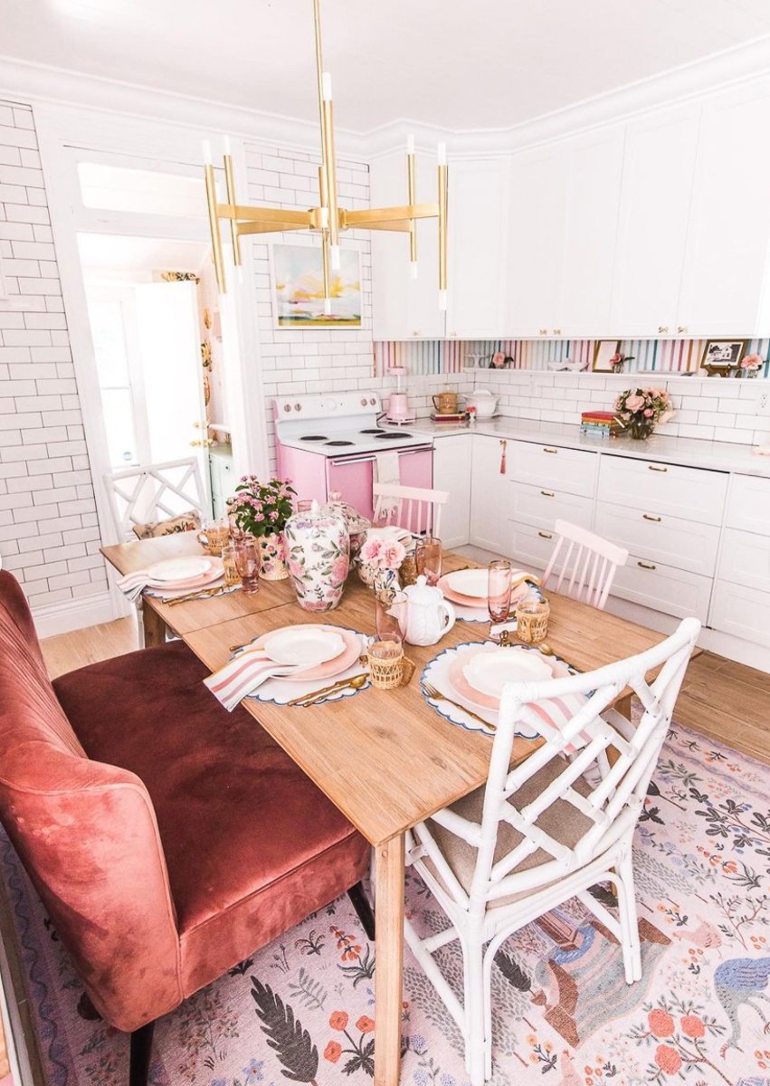 Cottage kitchen with pink stove and brass accents kellyelko.com