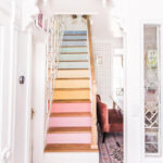 Eclectic Home Tour At Home with Ashley - love the rainbow painted stairs kellyelko.com
