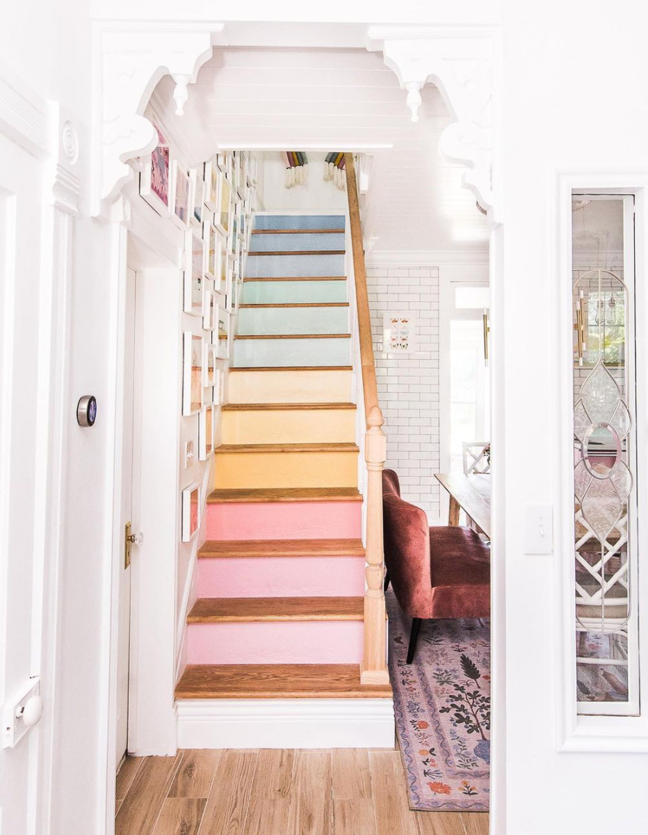 Love the rainbow stairs in this whimsical cottage home tour of At Home with Ashley kellyelko.com