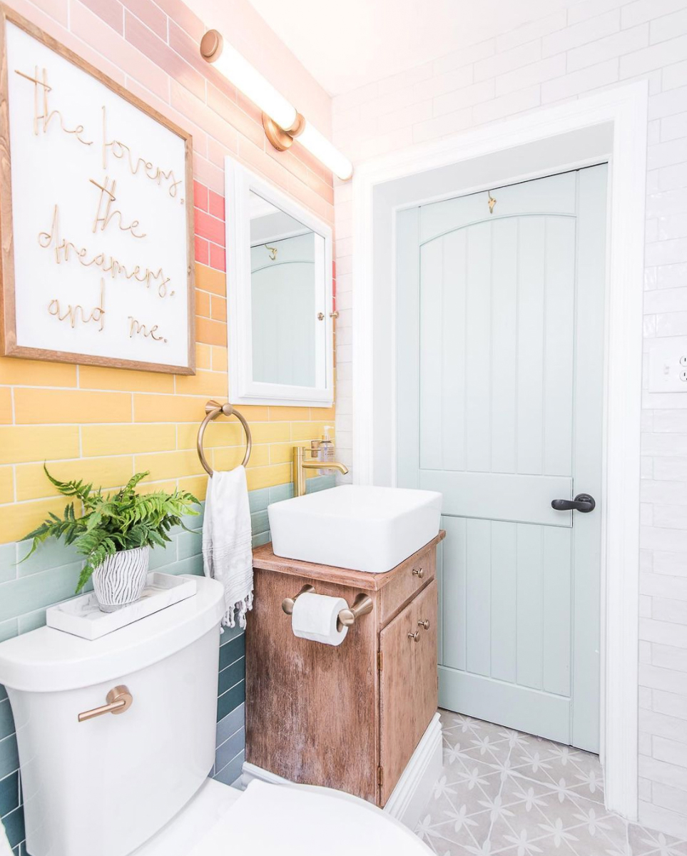 Love the way she laid the tile in a colorful rainbow pattern in this fun bathroom kellyelko.com