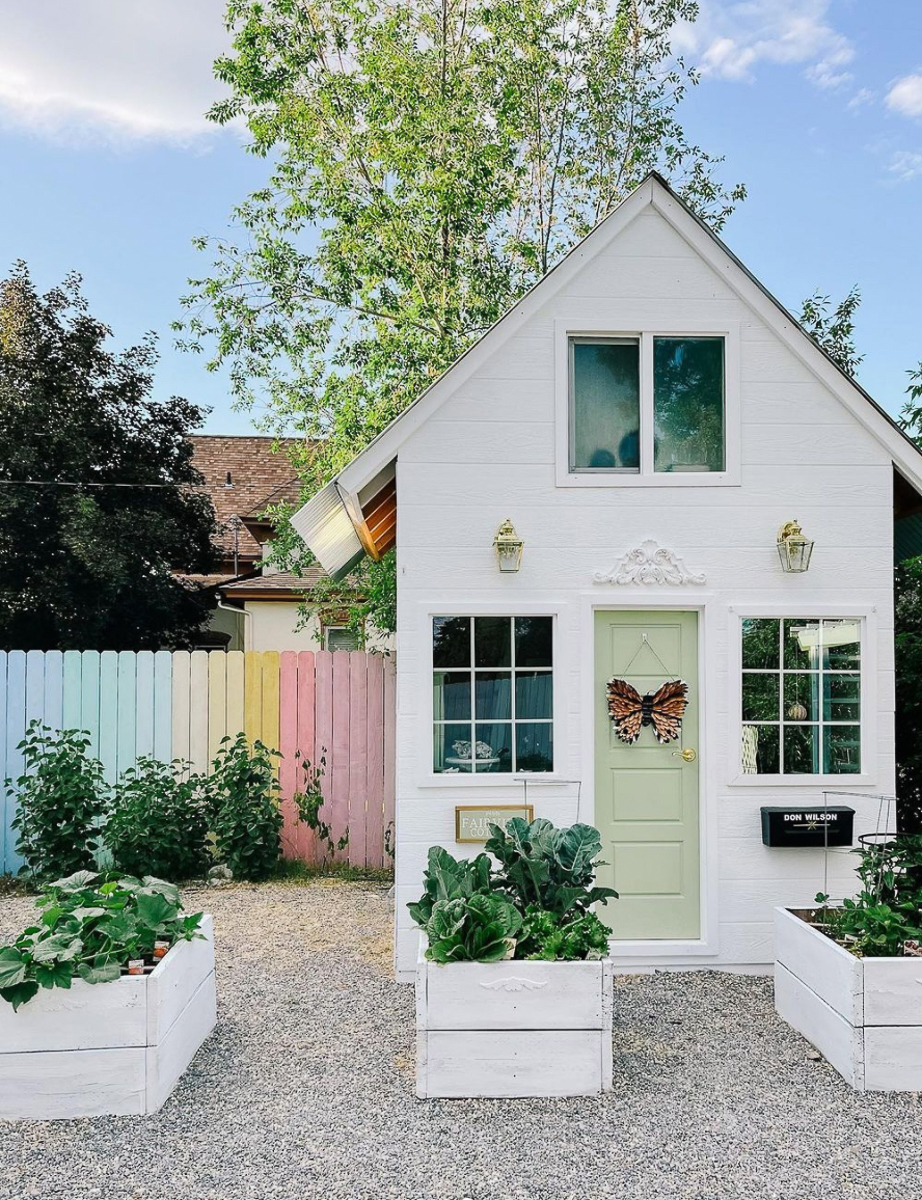 How adorable is this she shed and rainbow painted fence! kellyelko.com