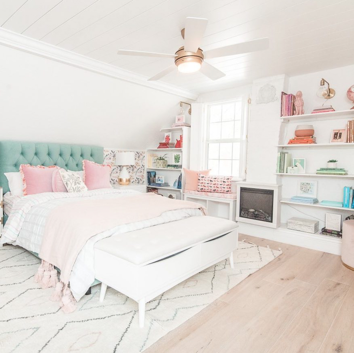Beautiful white bedroom with colorful accessories and thrifted finds kellyelko.com