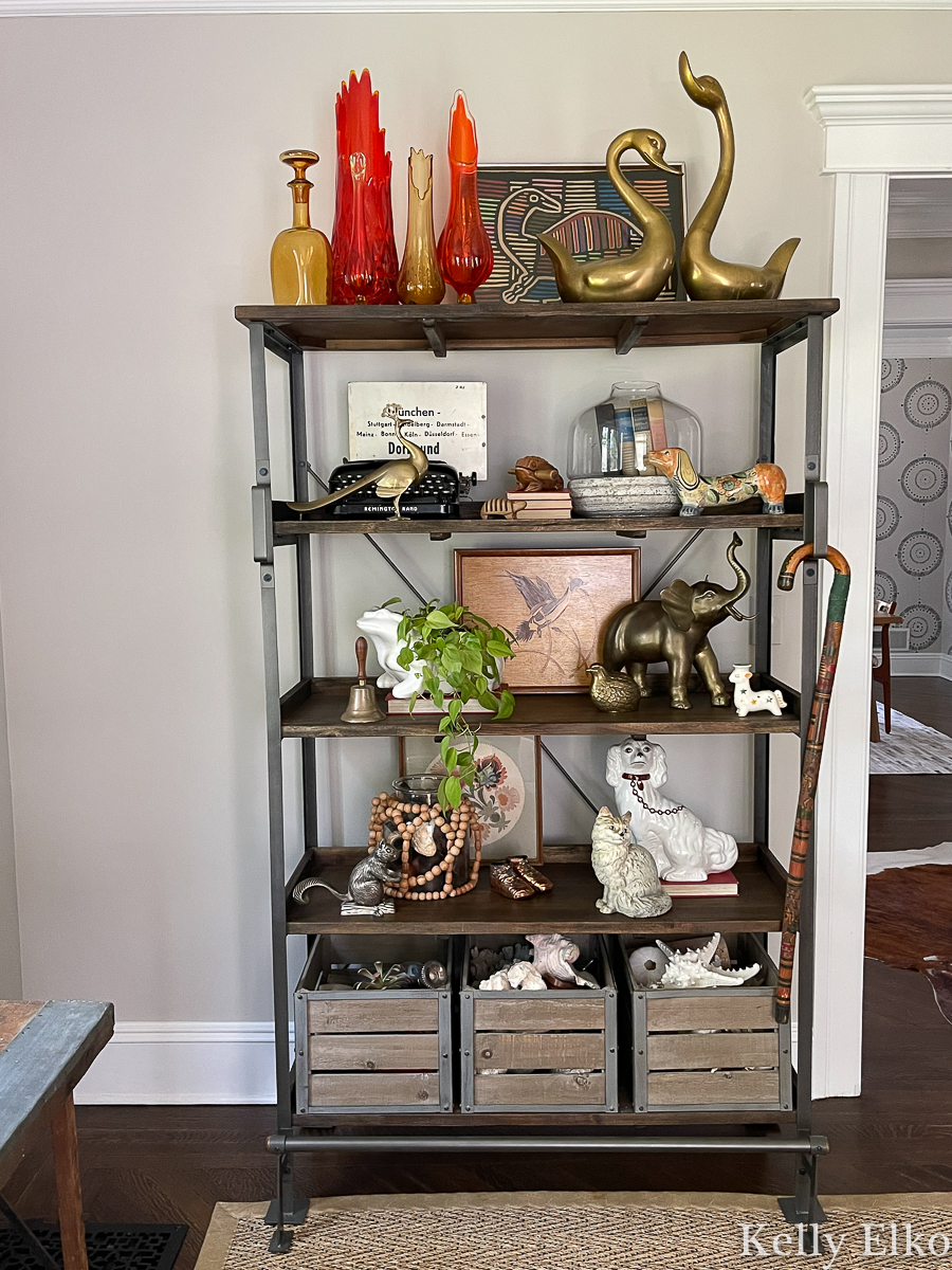 Shelf styling with vintage finds - love all the animal figurines and art kellyelko.com