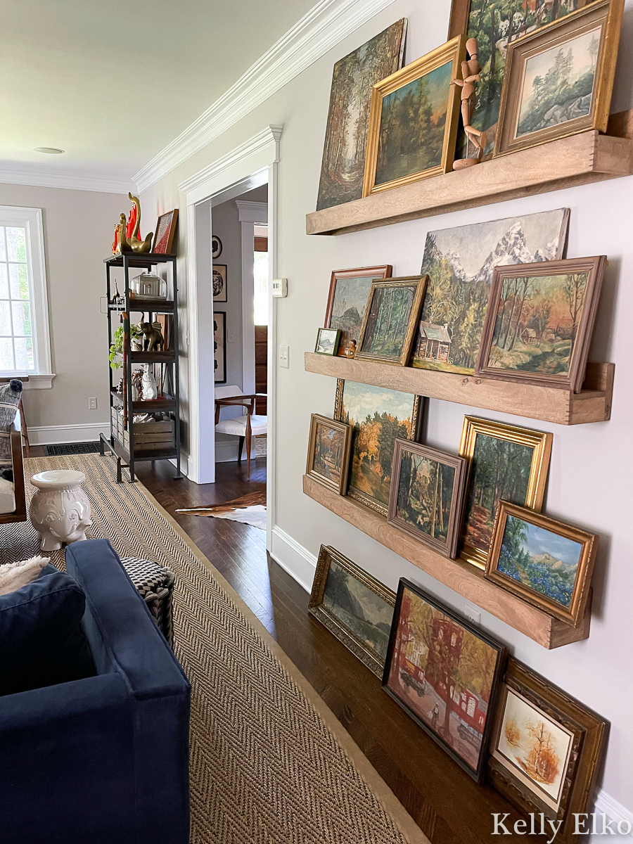 Stunning vintage landscape painting gallery wall - love the picture ledges for changing the look kellyelko.com
