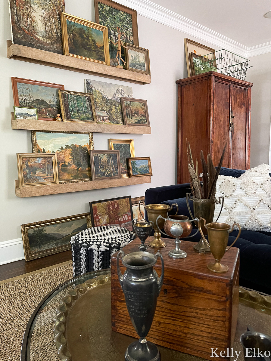 Stunning vintage landscape painting gallery wall - love the picture ledges for changing the look kellyelko.com - fall home tour