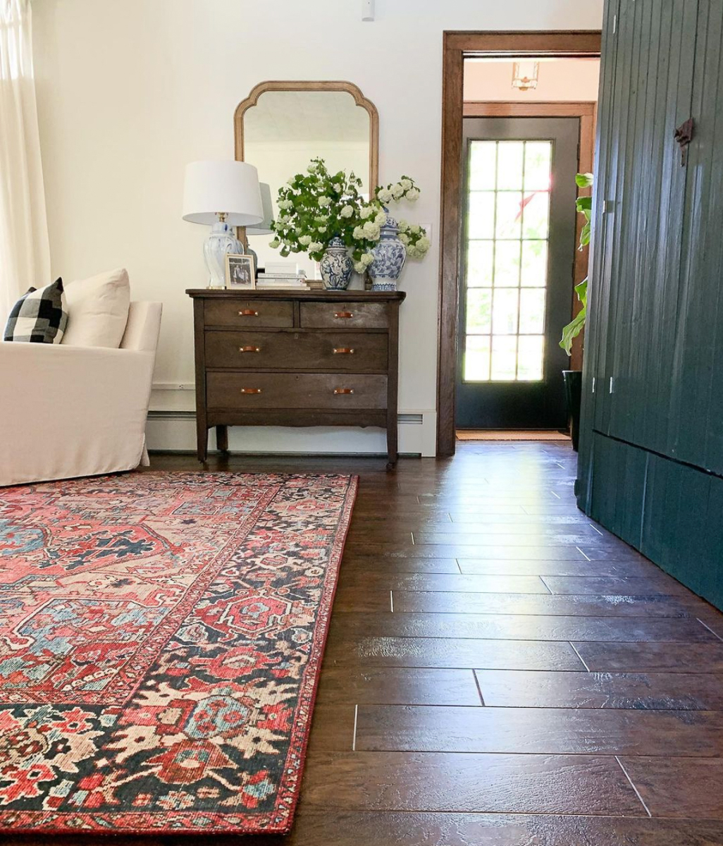 Beautiful farmhouse tour - love the antique furniture and huge green cabinet.