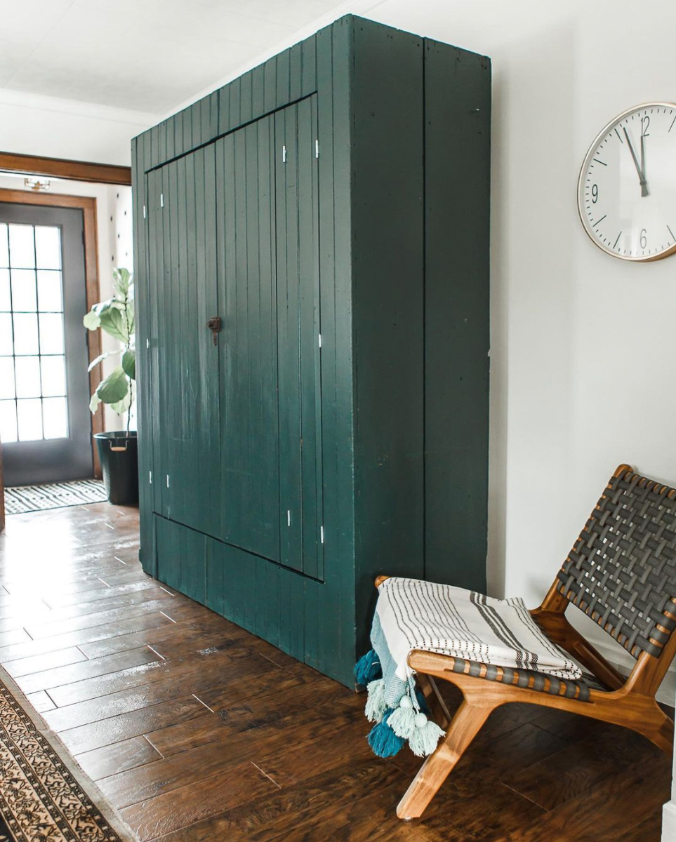 Antique cabinet in green is perfect for the TV kellyelko.com