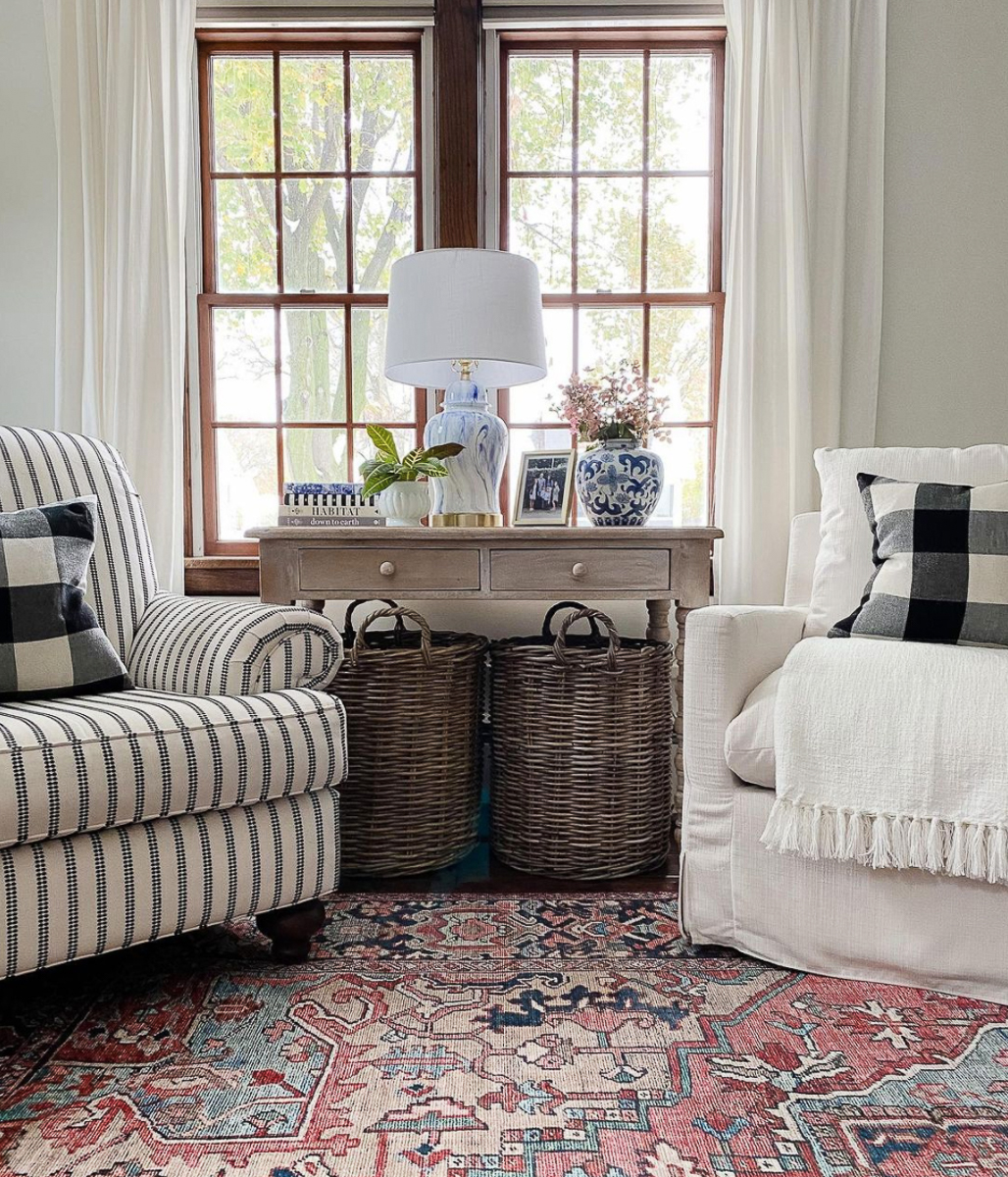 Create a cozy seating area with a pair of mismatched club chairs kellyelko.com