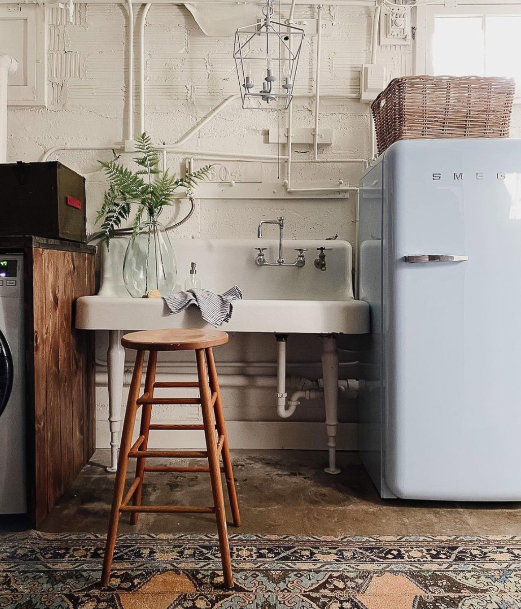 Love this basement laundry room with huge antique sink and Smeg refrigerator kellyelko.com