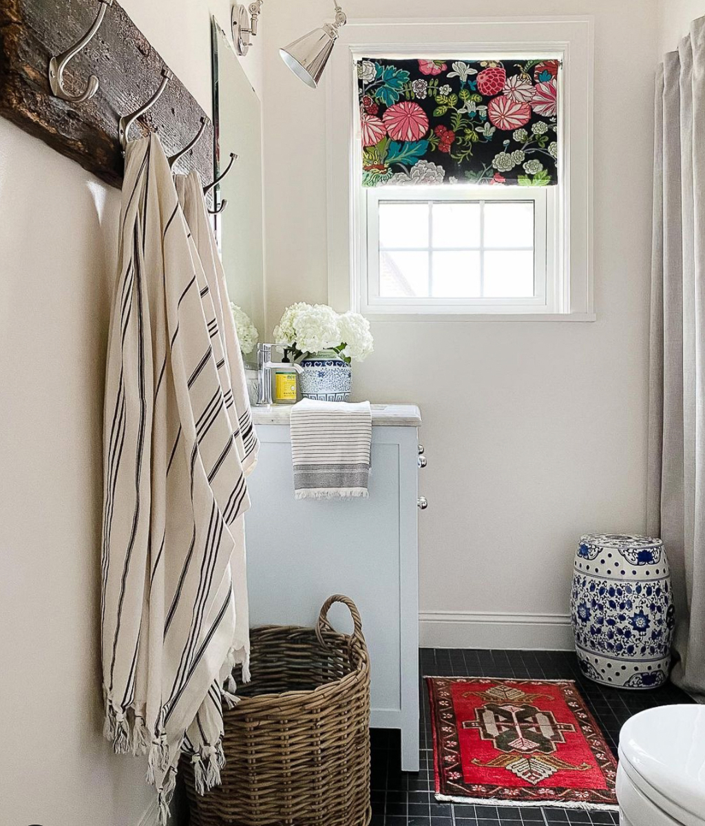 Small bathroom with white walls and black tile floor kellyelko.com